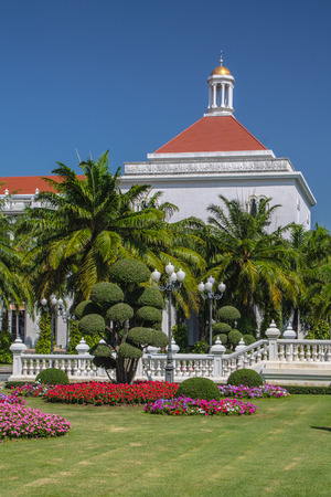 ordinances: Church in the garden on blue sky background  Stock Photo