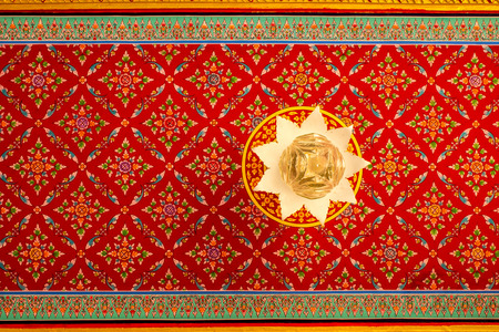 Thai painting and pattern and lotus light on the ceiling in temple, Thailand  photo