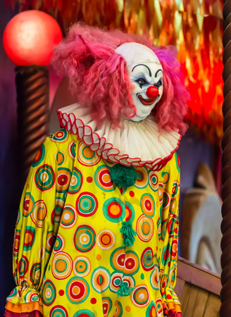 Scary clown robot in clown mask. photo