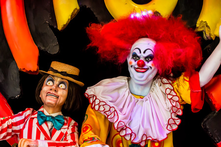 evil clown: Scary clown robot in clown mask.