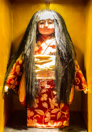 Japan scary old, broken doll stand. photo