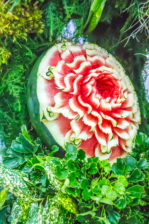 culinary skills: Watermelon carving in the form of flower on leaves.
