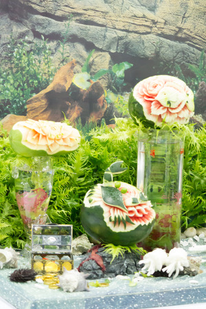 Watermelon and papaya  fruit carving  on table sets. photo