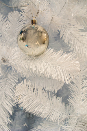 Close-up of Christmas ornaments on White Christmas tree Background. photo