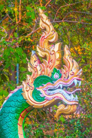 cherish: Naga sculpture on the wall inthe temple. Stock Photo