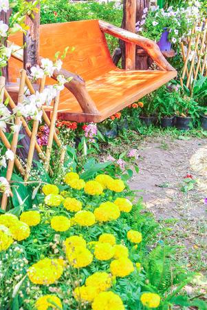 garden flower: Wood chair in the flowers garden.