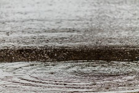 rain drop: Abstract background rain drop on the road.