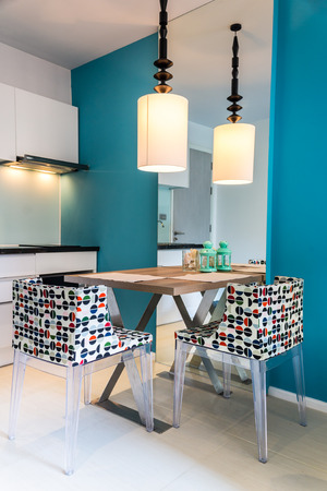 Modern small kitchen section in apartment.