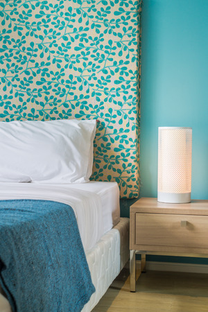 reading lamp: Wooden bedside table and reading lamp. Stock Photo