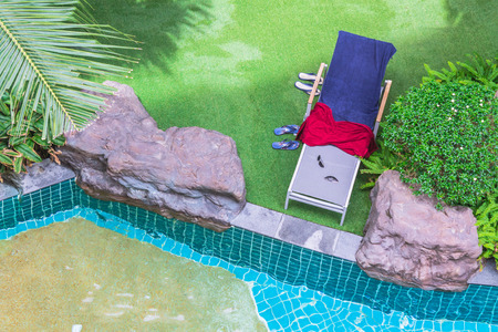 water grass: Top view of a garden with armchairs on the lawn and pool.