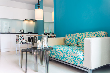 Relaxing Modern Living Room and Kitchen room Interior in apartment. Фото со стока