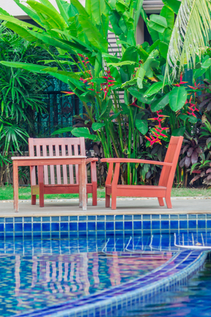 Relaxing Table Set Beside Swimming Pool. Stock Photo   48435869