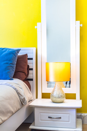 reading lamp: Interior Design: Modern Bedroom, White Wooden bedside table and reading lamp.