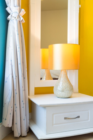 bedside lamp: Interior Design: Modern Bedroom, White Wooden bedside table and reading lamp.