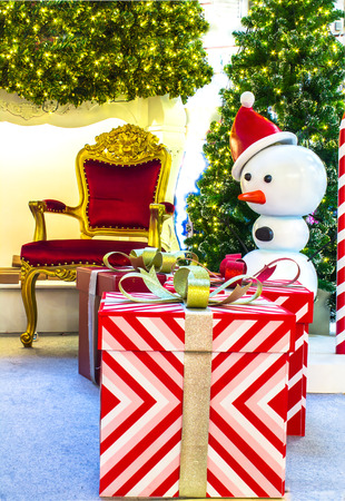 living space: Ready for CHristmas,  Adorned Christmas Tree , Chair ,  Fireplace, Snowman, Gift  inside Living space with copyspace.