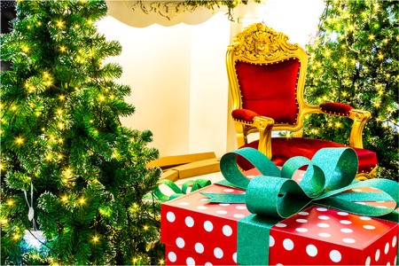 Ready for CHristmas,  Adorned Christmas Tree , Chair ,  Fireplace, Snowman, Gift  inside Living space with copyspace.
