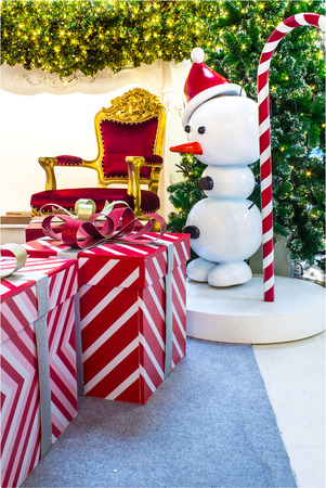 snow man party: Ready for CHristmas,  Adorned Christmas Tree , Chair ,  Fireplace, Snowman, Gift  inside Living space with copyspace.