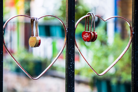 in loving memory: Red heart shaped lock concept of love hanging on heart rail bridge - retrostyled.