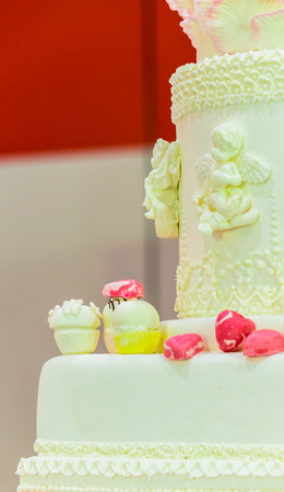 wedding feast: Sweet beauty flower and topping pastel color on wedding cake decoration. Stock Photo