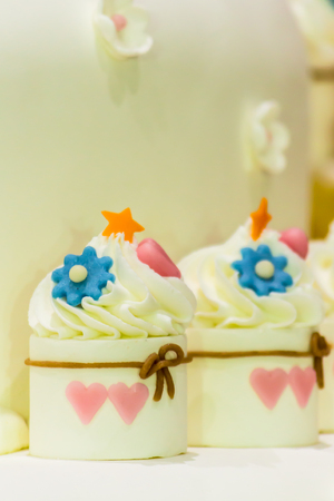 sugarcraft: Sweet beauty flower and topping pastel color on wedding cake decoration. Stock Photo