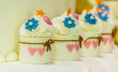 tier: Cupcakes on tier at wedding reception.
