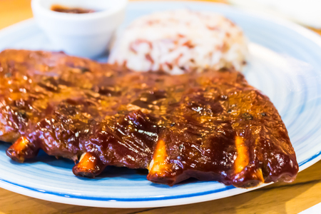 Homemade Plate of barbecue pork ribs and rice.