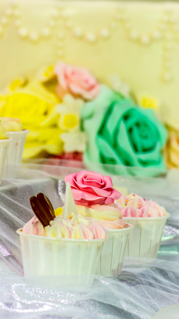 feast: Sweet beauty flower and topping pastel color on weddinng cake decoration.