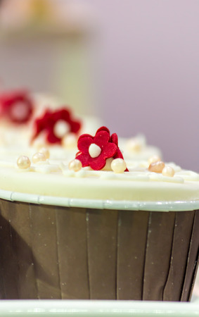 Cupcakes on tier at wedding reception.