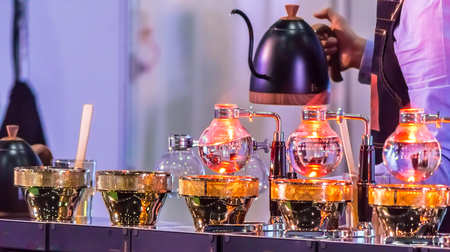 Syphon Coffee or Vacuum Coffee is full immersion tasteful, Blended smell and taste of roasted coffee with direct contact boiled water and show boiling water, stunning vacuum process by Beam heater. Standard-Bild