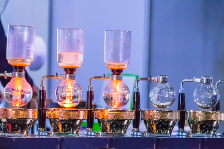 Syphon Coffee or Vacuum Coffee is full immersion tasteful, Blended smell and taste of roasted coffee with direct contact boiled water and show boiling water, stunning vacuum process by Beam heater. Stock Photo