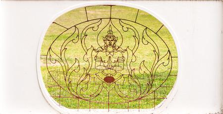 Thai art angel wrought iron style decoration on white concrete wall. 版權商用圖片