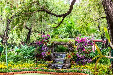 Waterfall flows decoration in cozy home flower garden on summer.