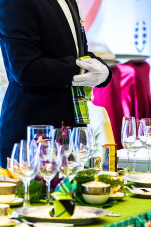 Waiter ready to service at Luxury party dinner in restaurant. Фото со стока