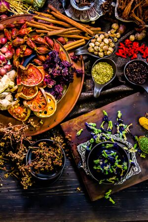 Top view Thai spices and herbs ingredient decoration on wood table for cook in home kitchen.