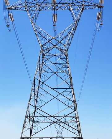 Electricity Energy Power Tower with Lot of Cables on Clear Blue Sky Background