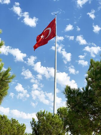 Turkish Flag Waves on Clear Sunny Partly Cloudy Weather Background