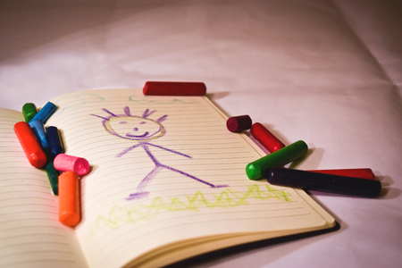 Crayons on notebook