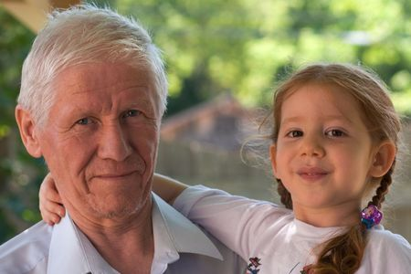 grand kids: Grandfather is holding smiling granddaughter. The older man isn�t clean-shaven. Don�t be too harsh to him � he just came from night shift and had no time to shave.