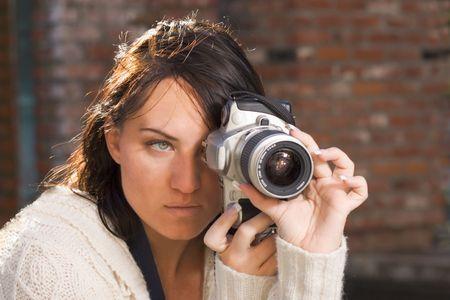 Girl shooting SLR photo camera photo