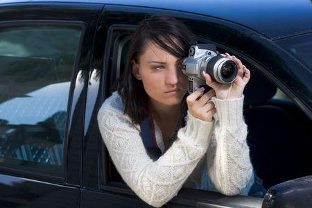 Girl shooting SLR photo camera Stock Photo - 754836