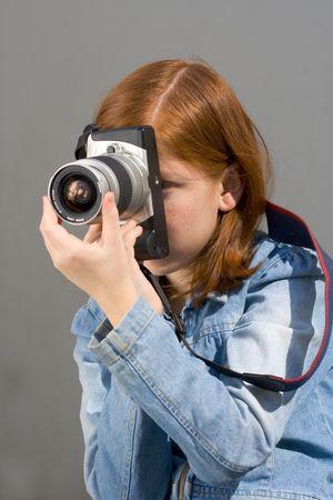 Girl shooting SLR photo camera Stock Photo - 760665