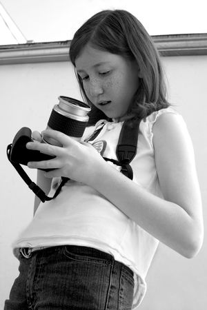 Girl with (old) SLR photo camera - B&W