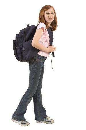 Schoolgirl standing with her blue backpack photo