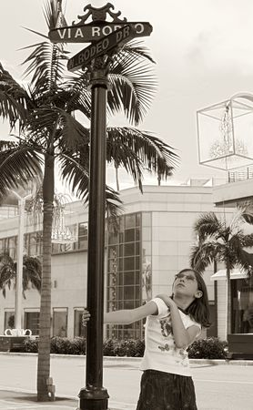 hollywood boulevard: Girl by Rodeo Drive street sign (Beverly Hills)