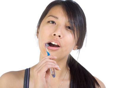 Girl brushing her teeth with toothbrush Stock Photo