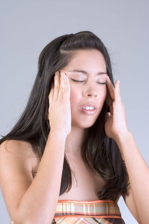 apparently: Young female squeezing her head apparently having headache