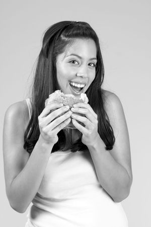 Smiling Female eats tasty hamburger Stock Photo - 815568