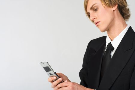 portrait of Businessman dialing out  on cell-phone