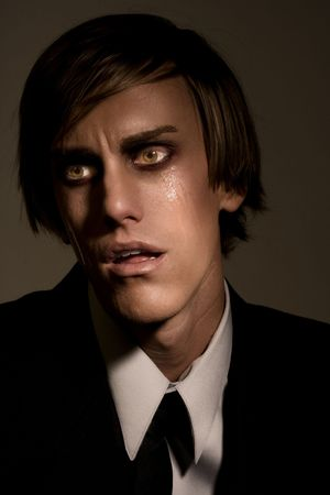 Portrait of male in tears shocked by news photo