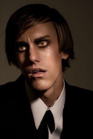 traumatized: Portrait of male in tears shocked by news